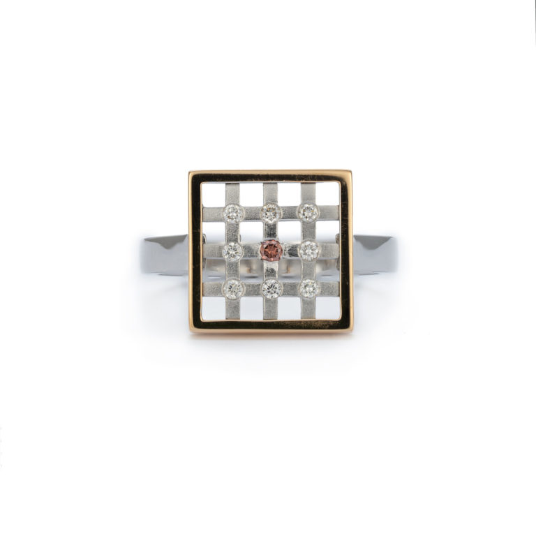 Geometric Ring with Pink and White Diamonds